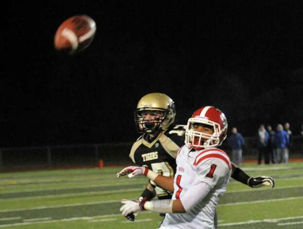 An incomplete pass is sent over Masuk's #1 Jason Pionkowski, during CIAC Class L boys football semifinal action against Daniel Hand in West Haven, Conn. on Saturday December 3, 2011. Hand defeated Masuk 35-14. Photo: Christian Abraham / Connecticut Post