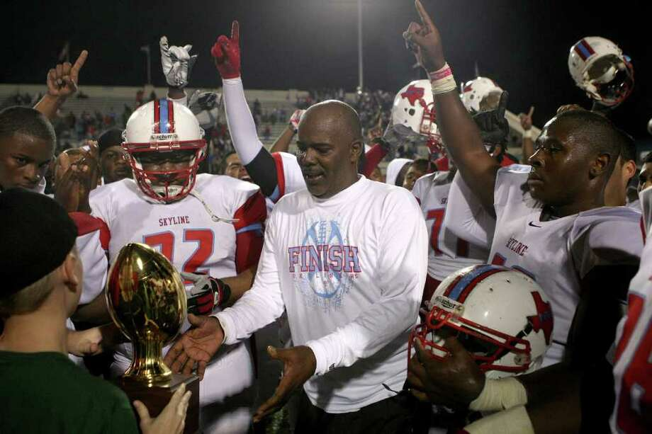 Dallas Skyline's head coach Reginald Samples receives the trophy after defeating The Woodlands during a high school football playoff game at Waco ISD Stadium in Waco on December 3, 2011. Photo: Khampha Bouaphanh / Khampha Bouaphanh