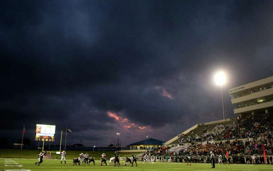 Storm clouds roll pass as Skyline plays The Woodlands in the second half during a high school football playoff game at Waco ISD Stadium in Waco on December 3, 2011. Photo: Khampha Bouaphanh / Khampha Bouaphanh
