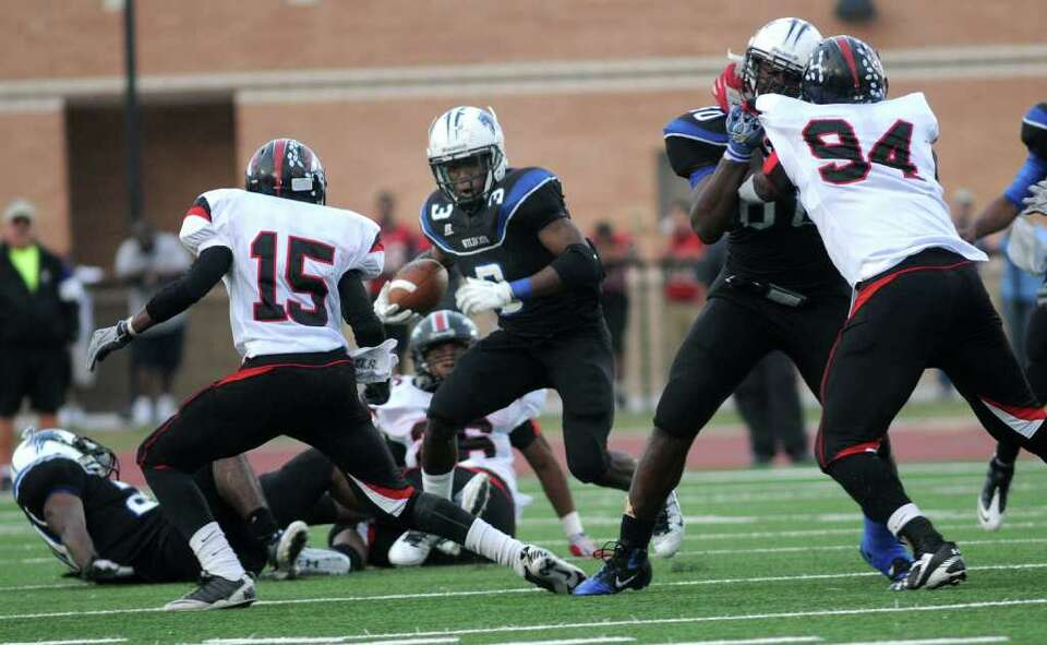 Dekaney senior running back Trey Williams (#3), with a block from teammate Armand Nance, looks for a