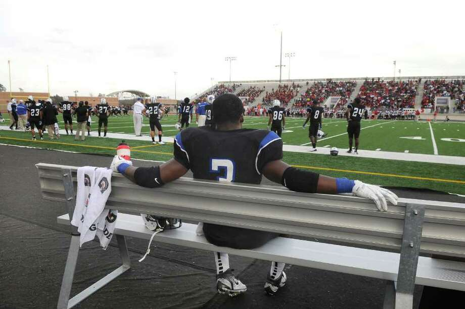 Dekaney senior running back Trey Williams takes a break on the bench during his team's regional final win over Westfield at Turner Stadium in Humble on Saturday. Freelance photo by Jerry Baker Photo: Jerry Baker, For The Chronicle