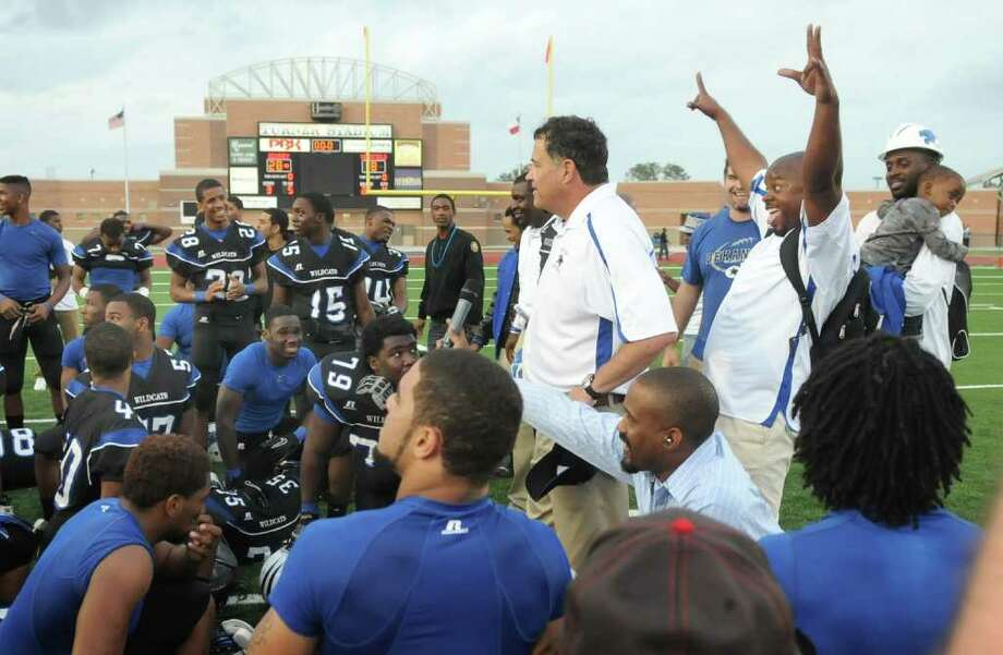 Dekaney Head Coach Willie Amendola, center, talks to his team after their win over the Westfield Mustangs in their regional final playoff game at Turner Stadium in Humble on Saturday. Freelance photo by Jerry Baker Photo: Jerry Baker, For The Chronicle