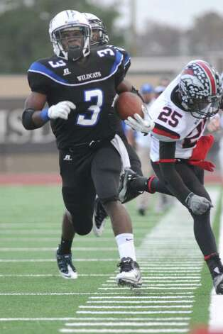 Dekaney senior running back Trey Williams (#3) runs for his second 3rd quarter touchdown against Westfield's senior defensive back Julius Lockett (#25) during their regional final playoff game at Turner Stadium in Humble on Saturday. Freelance photo by Jerry Baker Photo: Jerry Baker, For The Chronicle