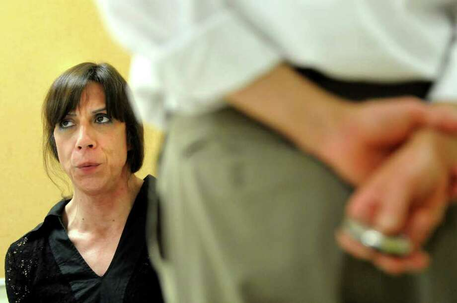 Frances Lopez of Delmar, left, exercises her vocal chords to increase their flexibility with adjunct professor Dan Kayajian during a voice modification class for transgender clients on Monday, June 27, 2011, at the College of Saint Rose in Albany, N.Y. (Cindy Schultz / Times Union) Photo: Cindy Schultz