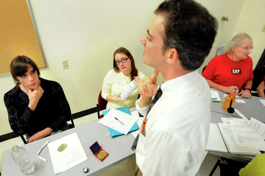 Frances Lopez of Delmar, left, exercises her vocal chords to increase their flexibility with adjunct professor Dan Kayajian and student clinician Corinne Chester during a voice modification class for transgender clients on Monday, June 27, 2011, at the College of Saint Rose in Albany, N.Y. At right is client Wendy Moore of Albany. (Cindy Schultz / Times Union)