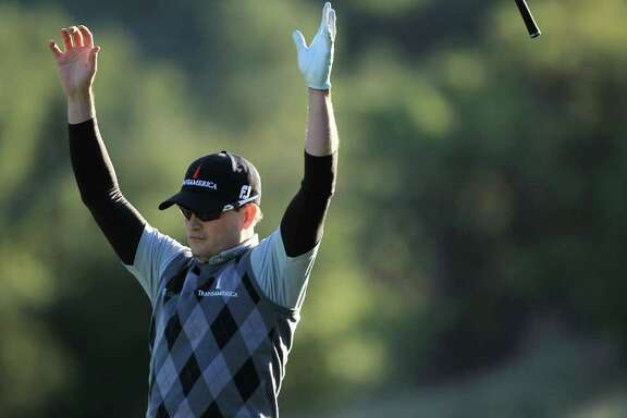 SCOTT HALLERAN : GETTY IMAGES CAUSING A FLAP:  Zach Johnson sends his club flying after holing out for eagle on the 18th hole Saturday during the third round of the Chevron World Challenge.