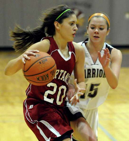 Scotia's Cassie Broadhead ,left, is defended by Stillwater's Kassey Wichelns during their varsity gi
