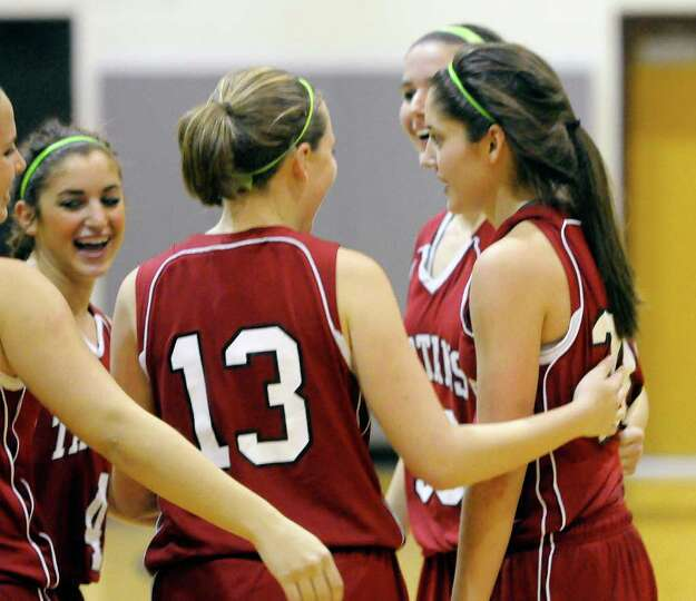 Scotia's Cassie Broadhead ,right, is congratulated by teammates after scoring her 1000 point playing