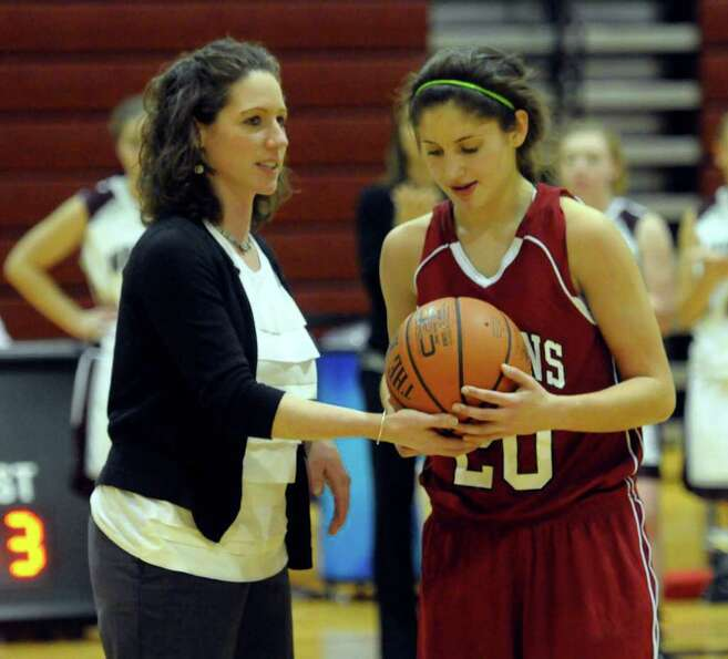Scotia's Girls Varsity Basketball Coach Regan Burns ,left, presents Cassie Broadhead  with the game