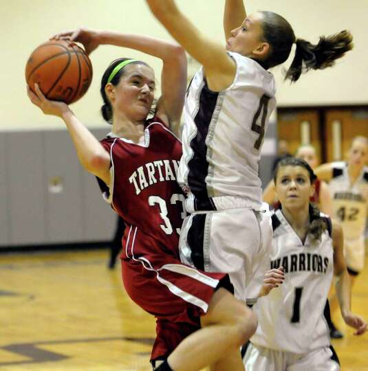 Scotia's Sarah Jansen (33) is defended by Stillwater's Subrina Zehner (4) during their Girls Varsity