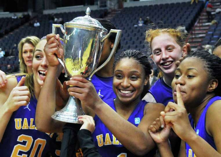 UAlbany women's team mates with the Albany Cup after defeating Siena in their annual game at the Tim