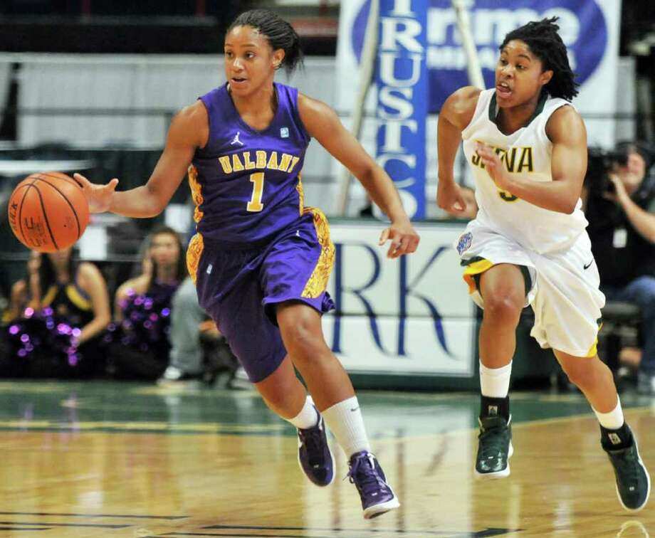 UAlbany's #1 Cassandra Callaway, left, and Siena's #5, Ciara Stewart during their annual game at the Times Union Center in Albany Saturday Dec. 3, 2011.   (John Carl D'Annibale / Times Union) Photo: John Carl D'Annibale / 00015589A