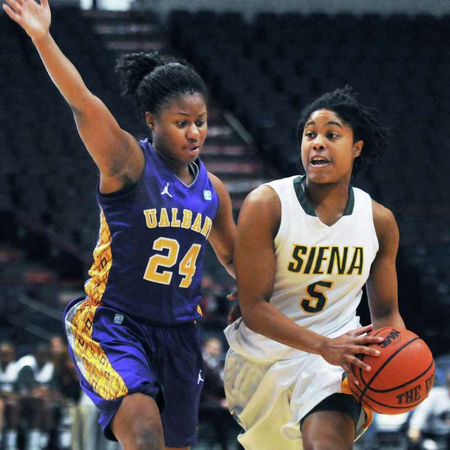 UAlbany's #24 Adrienne Jones, left, and Siena's #5 Ciara Stewart during their annual game at the Times Union Center in Albany Saturday Dec. 3, 2011.   (John Carl D'Annibale / Times Union) Photo: John Carl D'Annibale / 00015589A