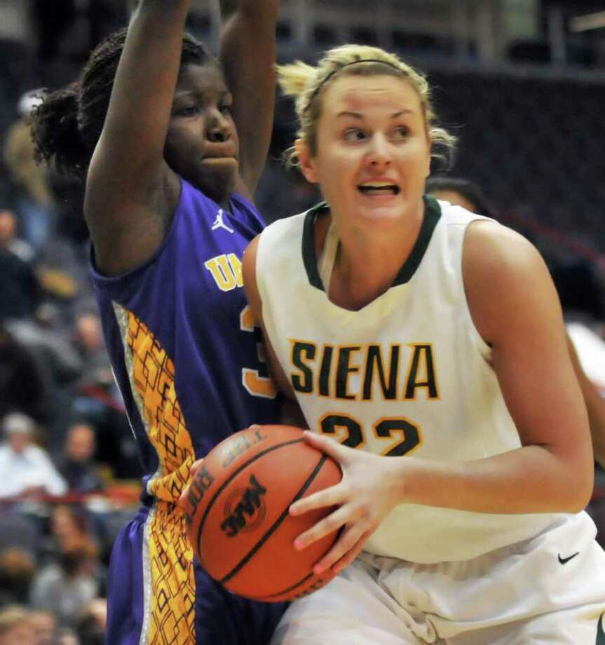 UAlbany's #33Tabitha Makopondo, left, and Siena's #22, Lily Grnci during the annual UAlbany- Siena game at the Times Union Center in Albany Dec. 3, 2011.   (John Carl D'Annibale / Times Union) Photo: John Carl D'Annibale / 00015589A