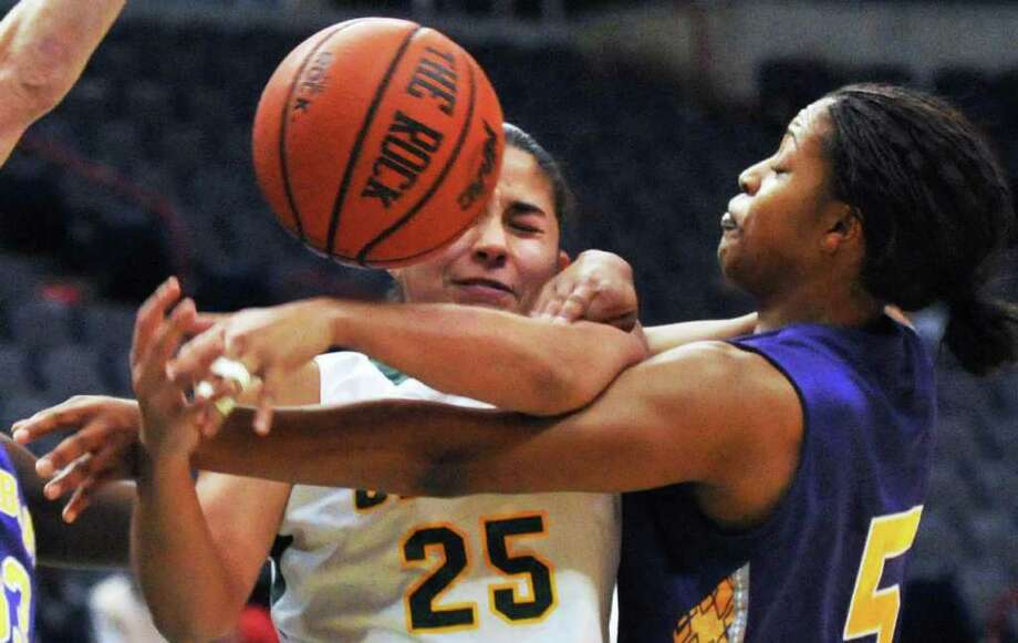 Siena's #25 Cristina Centeno, left, and UAlbany's # 5 Ebone Henry during their annual game at the Times Union Center in Albany Saturday Dec. 3, 2011.   (John Carl D'Annibale / Times Union) Photo: John Carl D'Annibale / 00015589A