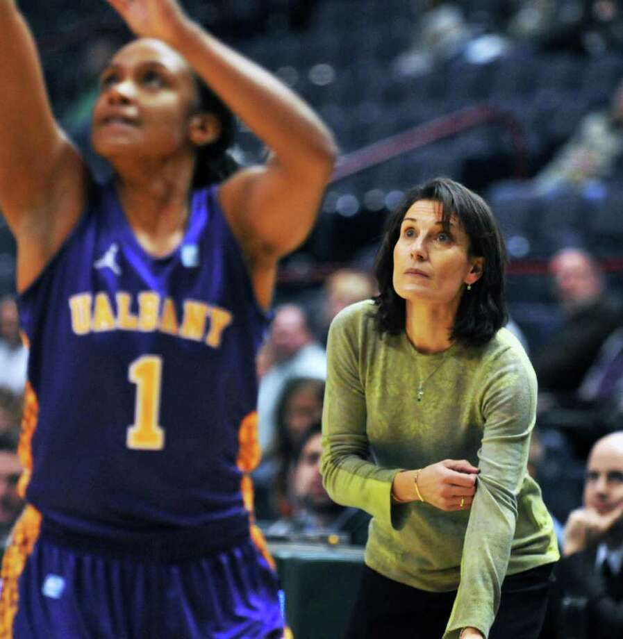 UAlbany's #1 Cassandra Callaway, left, shoots as Siena coach Gina Castelli looks on during their annual game at the Times Union Center in Albany Saturday Dec. 3, 2011.   (John Carl D'Annibale / Times Union) Photo: John Carl D'Annibale / 00015589A