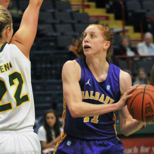 UAlbany's #11 Julie Forster, at right, moves in for a shot during the annual UAlbany Siena game at t