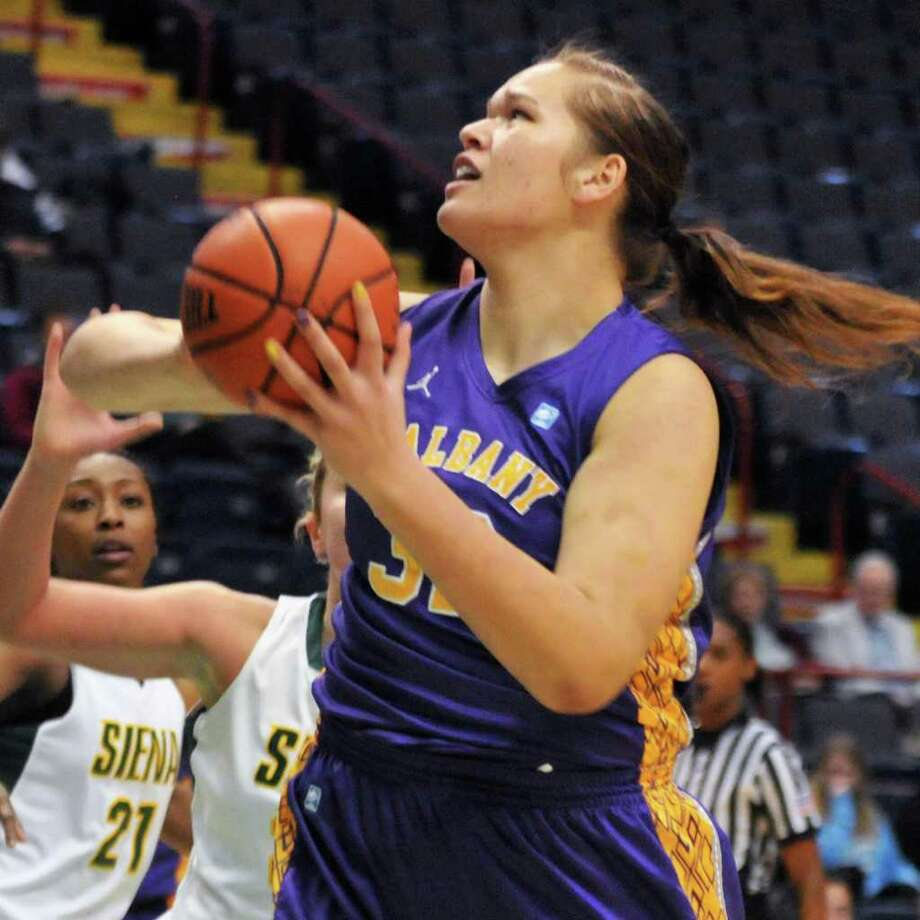 UAlbany's 6-foot-9 center Megan Craig scores a goal against  Siena women in their annual game at the Times Union Center in Albany Dec. 3, 2011.   (John Carl D'Annibale / Times Union) Photo: John Carl D'Annibale / 00015589A