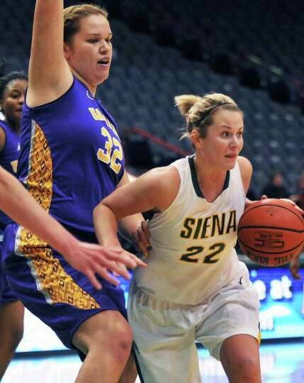 UAlbany's 6-foot-9 center Megan Craig, #32 left, and Siena's #22 Lily Grenci during their annual gam