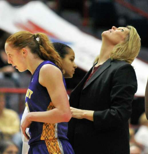 UAlbany's #11 Julie Forster, left, as coach Katie Abrahamson-Henderson checks the score board during