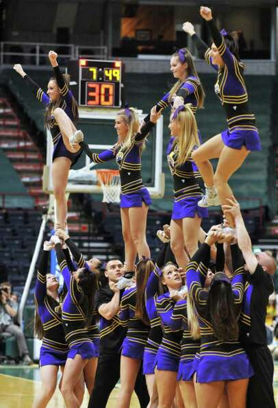 UAlbany Cheer Team performs during  their annual game against  Siena women at the Times Union Center