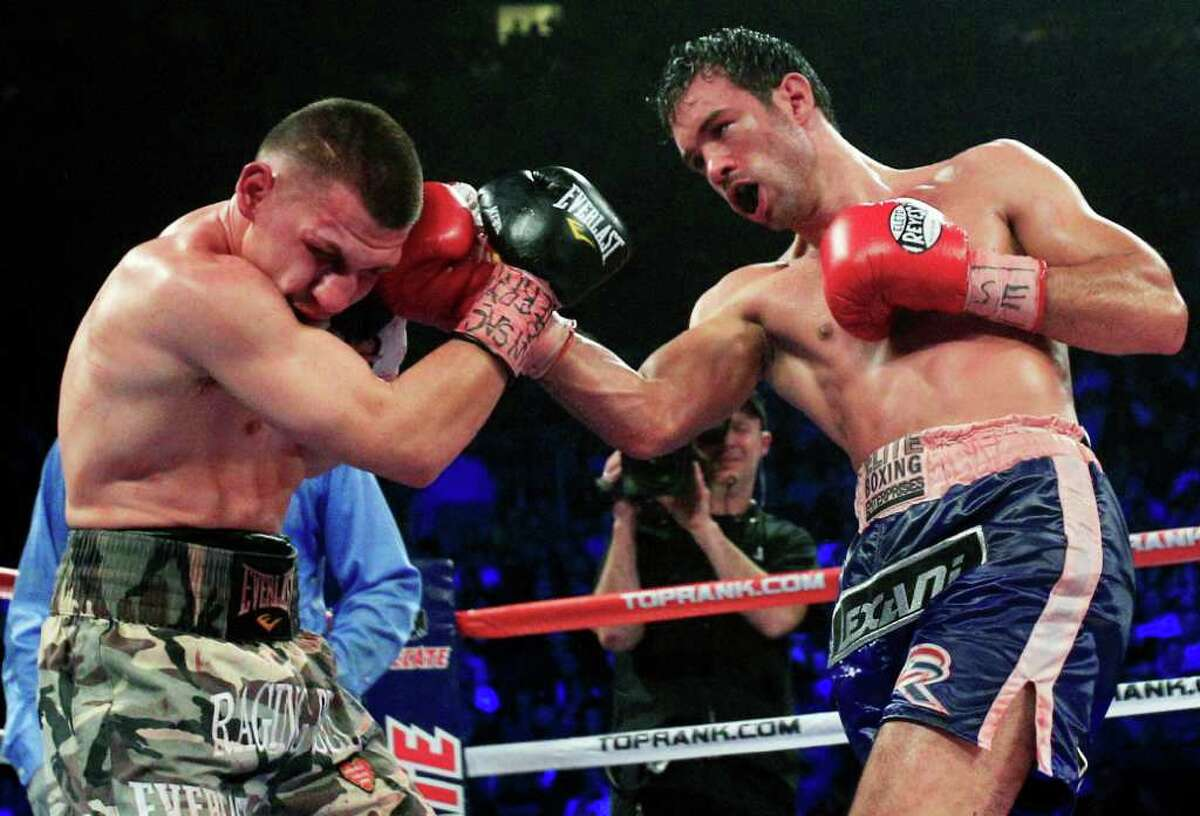 Delvin Rodriguez, right, punches Pawel Wolak during IBA world junior middleweight championship boxing match Saturday, Dec. 3, 2011 in New York. Rodriguez won the fight. (AP Photo/Frank Franklin II)