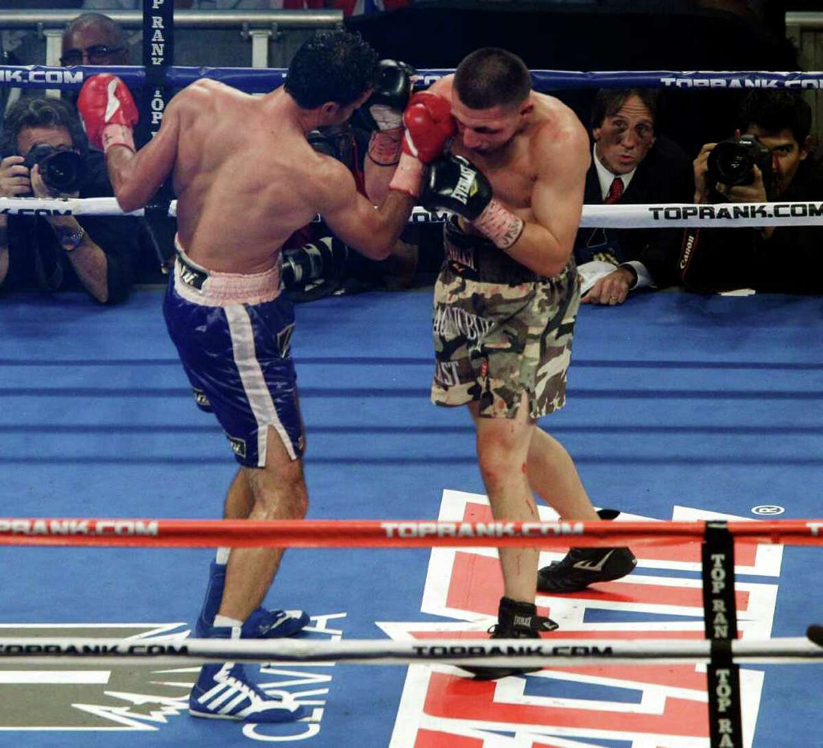 Devlin Rodriguez, left, punches Pawel Wolak during the IBA junior middleweight championship boxing match, Saturday, Dec. 3, 2011, at Madison Square Garden in New York. (AP Photo/Mary Altaffer)
