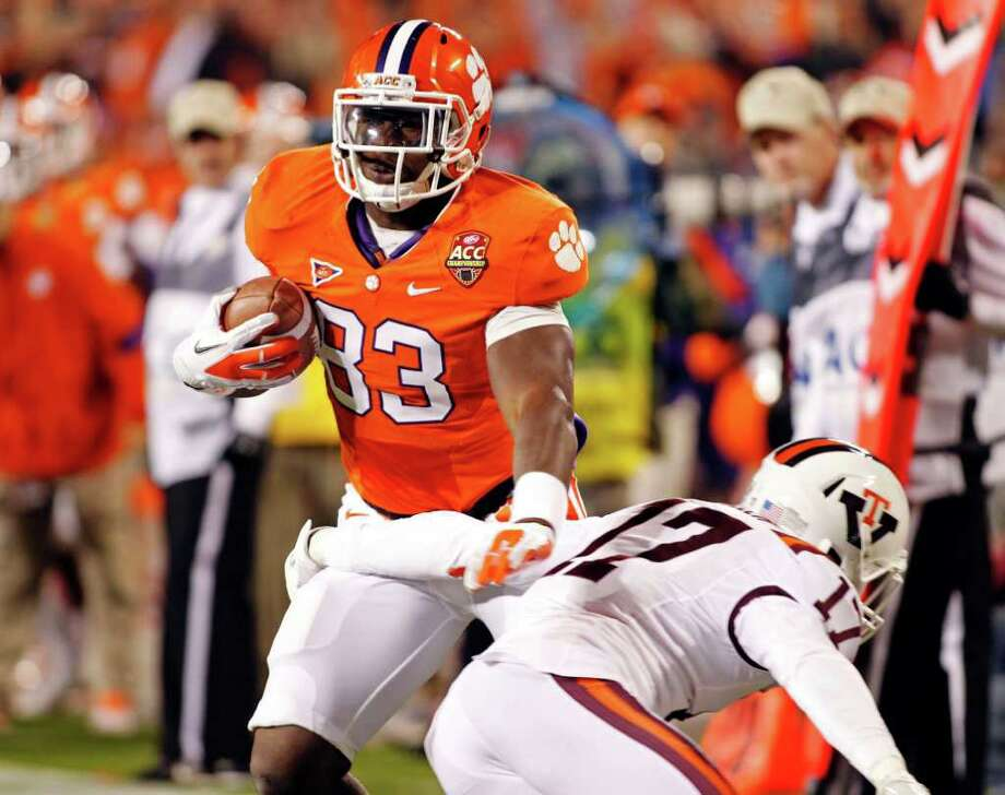 Clemson's Dwayne Allen runs past Virginia Tech's Kyle Fuller for a touchdown during the first half. Photo: AP