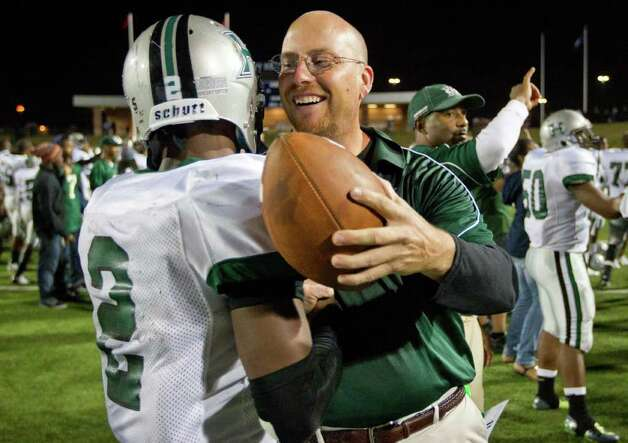 SMILEY N. POOL : CHRONICLE WELL DONE: Hightower coach Barry Abercrombie hugs quarterback Bralon Addison after the Hurricanes defeated Pearland for the Class 5A Division I Region III championship. Photo: Smiley N. Pool / © 2011  Houston Chronicle