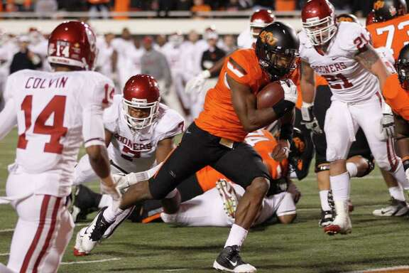 SUE OGROCKI: AP POKES POUR IT ON: Joseph Randle adds to the Oklahoma State onslaught by scoring on a 2-yard run.