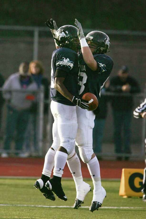 Ansonia High School's  # 2  Arkeel Newsome celebrates his touchdown with teammate #18 Matthew Castillo during first half action against Berlin High School at Saturday's CIAC football semifinal at Sheehan High School in Wallingford, Conn. Photo: Mike Ross / Connecticut Post Freelance