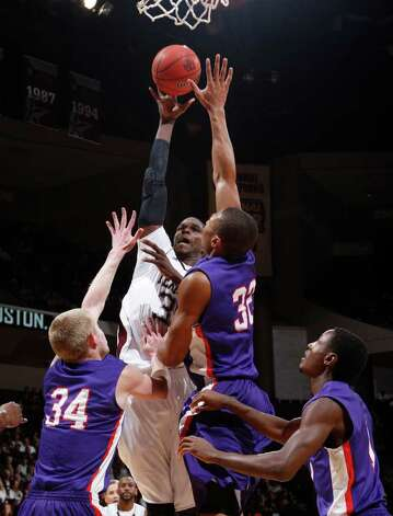 Texas A&M's Ray Turner (35) shoots the ball over Stephen F. Austin's Jacob Parker (34), Taylor Smith (32) and Hal Bateman (4) during the first half of an NCAA college basketball game on Saturday, Dec. 3, 2011, in College Station. Texas A&M won 55-42. Photo: Associated Press