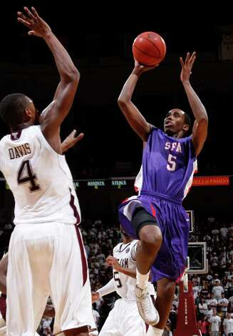 Stephen F. Austin's Antonio Bostic (5) shoots the ball over Texas A&M defender Keith Davis (4) during the second half of an NCAA college basketball game on Saturday, Dec. 3, 2011, in College Station. Texas A&M won 55-42. Photo: Associated Press