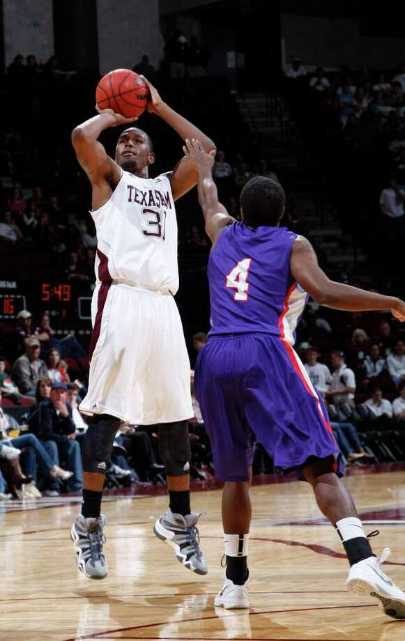 Texas A&M's Elston Turner (31) shoots the ball over Stephen F. Austin defender Hal Bateman (4) during the first half of an NCAA college basketball game on Saturday, Dec. 3, 2011, in College Station. Texas A&M won 55-42. Photo: Associated Press