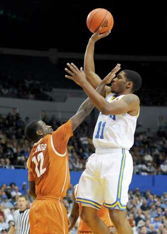 Texas guard Myck Kabongo (12) gets a hand in UCLA guard Lazeric Jones (11) face who shoots during the second half of an NCAA college basketball game on Saturday, Dec. 3, 2011, in Los Angeles.  Texas won 69-59. Photo: Associated Press
