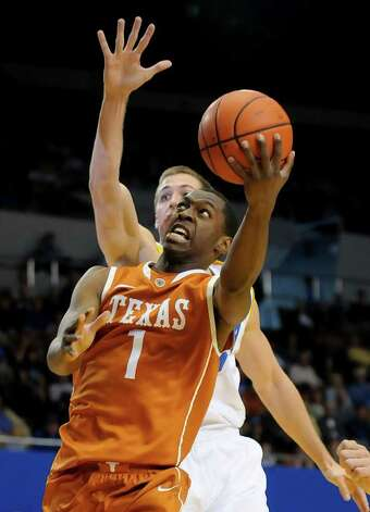 Texas guard Sheldon McClellan (1) gets by UCLA forward David Wear, back, for a basket on a fast break during the first half of an NCAA college basketball game on Saturday, Dec. 3, 2011, in Los Angeles. Photo: Associated Press