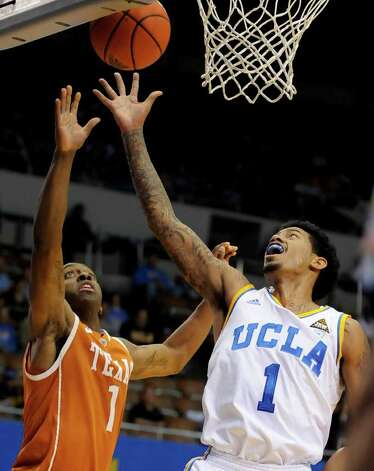 UCLA guard Tyler Lamb (1) drives on Texas guard Sheldon McClellan (1) for a basket during the first half of an NCAA college basketball game on Saturday, Dec. 3, 2011, in Los Angeles. Texas won 69-59. Photo: Associated Press