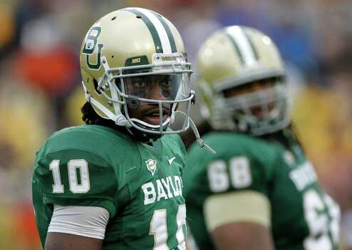 Baylor quarterback Robert Griffin III (10) in the first half of an NCAA college football game against Texas Saturday, Dec. 3, 2011, in Waco, Texas. (AP Photo/Tony Gutierrez) Photo: Tony Gutierrez, Associated Press / AP