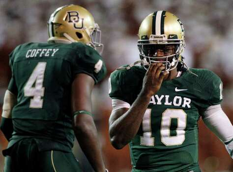 Baylor linebacker Elliot Coffey (4) and quarterback Robert Griffin III in the second half of an NCAA college football game Saturday, Dec. 3, 2011, in Waco, Texas. Baylor won 48-24. (AP Photo/Tony Gutierrez) Photo: Tony Gutierrez, Associated Press / AP