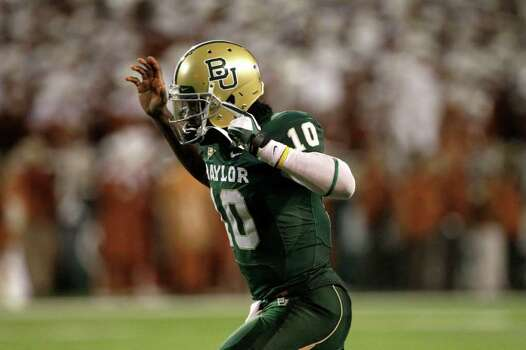 Baylor quarterback Robert Griffin III (10) runs onto the field in the second half of an NCAA college football game against Texas Saturday, Dec. 3, 2011, in Waco, Texas. Baylor won 48-24. (AP Photo/Tony Gutierrez) Photo: Tony Gutierrez, Associated Press / AP
