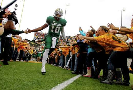 WACO, TX - DECEMBER 03:  Robert Griffin III #10 of the Baylor Bears runs onto the field before a game against the Texas Longhorns at Floyd Casey Stadium on December 3, 2011 in Waco, Texas. Photo: Sarah Glenn, Getty / 2011 Getty Images