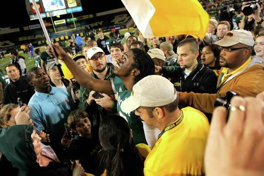 WACO, TX - DECEMBER 03:  Robert Griffin III #10 of the Baylor Bears waves a Baylor flag after a game against the Texas Longhorns at Floyd Casey Stadium on December 3, 2011 in Waco, Texas. The Baylor Bears defeated the Texas Longhorns 48-24. Photo: Sarah Glenn, Getty / 2011 Getty Images