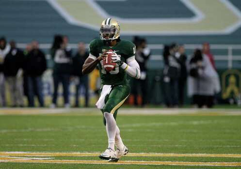 Baylor quarterback Robert Griffin III prepares to pass in the second half of an NCAA college football game against Texas Saturday, Dec. 3, 2011, in Waco, Texas. Griffin III ran for two touchdowns and passed for two more to lead No. 19 Baylor to a 48-24 win over Texas.  (AP Photo/Tony Gutierrez) Photo: Tony Gutierrez, Associated Press / AP