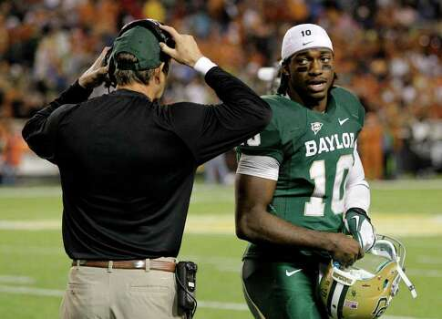 Baylor quarterback Robert Griffin III (10) talks to head coach Art Briles on the sideline in the second half of an NCAA college football game against Texas, Saturday, Dec. 3, 2011, in Waco, Texas. Baylor won 48-24. (AP Photo/Tony Gutierrez) Photo: Tony Gutierrez, Associated Press / AP