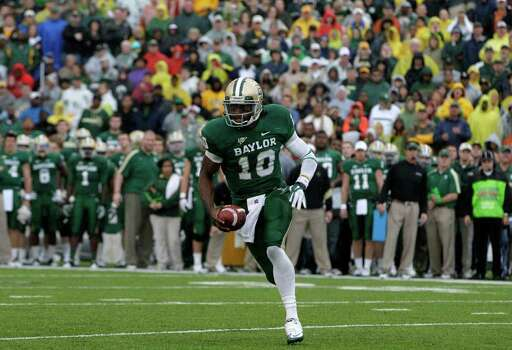 Baylor quarterback Robert Griffin III (10) finds running room against Texas in the first  half of an NCAA college football game Saturday, Dec. 3, 2011, in Waco, Texas. (AP Photo/Tony Gutierrez) Photo: Tony Gutierrez, Associated Press / AP