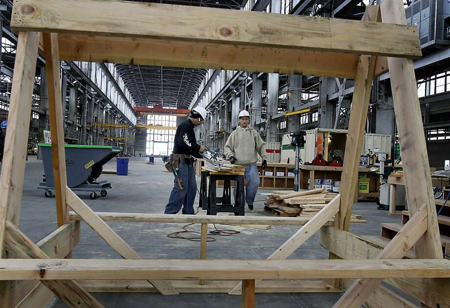 Workers at the Blu Homes plant cut wood for benches and saw horses. Blu Homes, a prefabricated home builder, has opened up a huge manufacturing plant at Vallejo's Mare Island area, in an old hangar that was used to build submarines. Photo: Brant Ward, The Chronicle