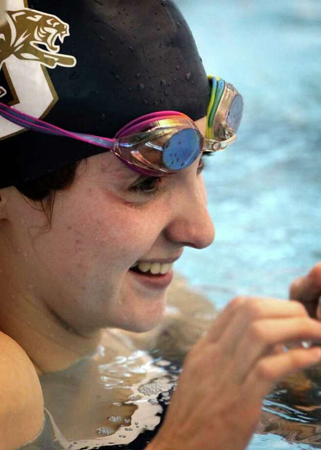 Abby McAlpin, a medal winner in this year's World Deaf Swimming Championships, practices at Northside Natatorium.  The  junior at O'Connor High School plans to return to the 2013 Deaflympics. Photo: BOB OWEN, SAN ANTONIO EXPRESS-NEWS / rowen@express-news.net