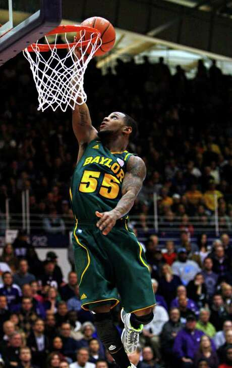 Baylor's Pierre Jackson goes in for a layup in the first half against Northwestern. He had 16 points. Photo: AP