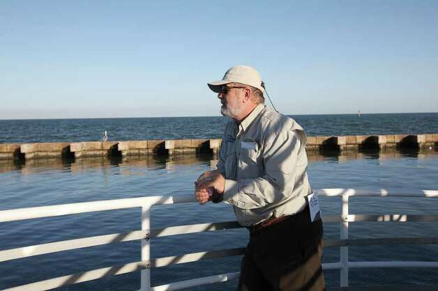 The Aransas Project Director Ron Outen prepares to disembark in Fulton, Texas after a whooping crane tour in the Aransas National Wildlife Refuge, Tuesday, Nov. 29, 2011. The Aransas Project is suing officials with the Texas Commission on Environmental Quality for what they content is a failure to control the flow of fresh water from the rivers that empty into the refuges that contributed to the death of whooping cranes between 2008-2009. With the ongoing drought and low river water flow, high salinity in the waters of the bay caused a bloom of red tide that lead to the closing of the oyster season and the decline in blue crabs. The crabs are the main source of food for the cranes. Photo: JERRY LARA, Jerry Lara/glara@express-news.net / SAN ANTONIO EXPRESS-NEWS