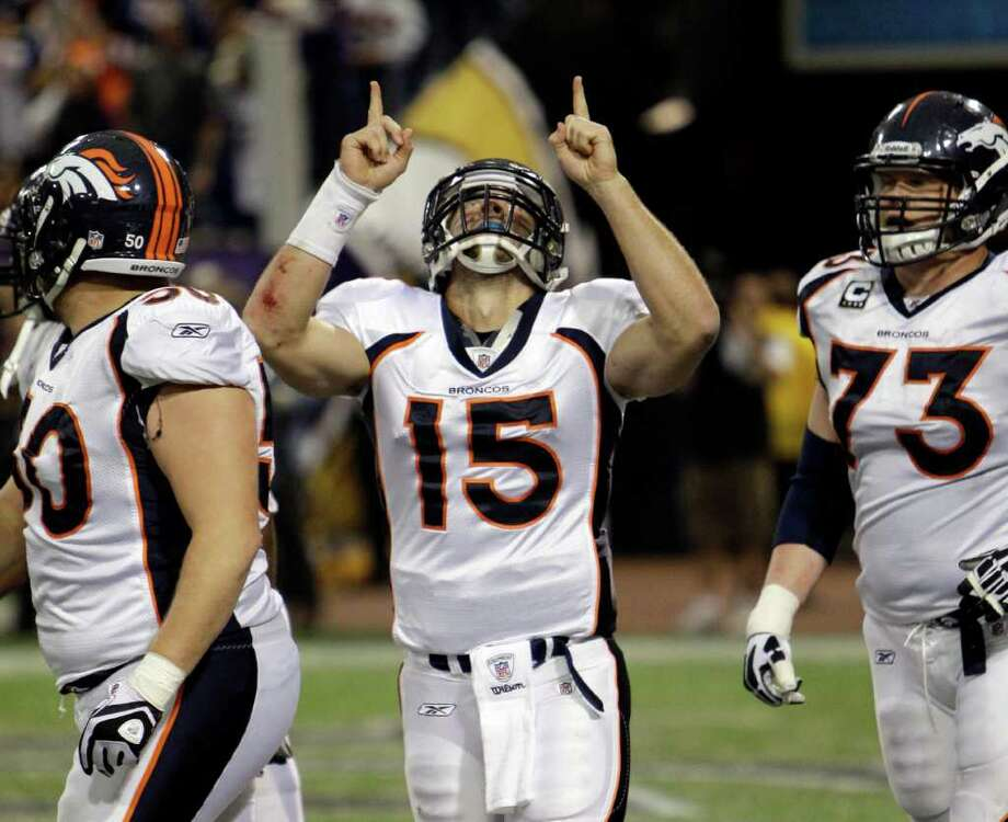 Tim Tebow reacts after running in for a 2-point conversion during the second half against Minnesota. Photo: AP